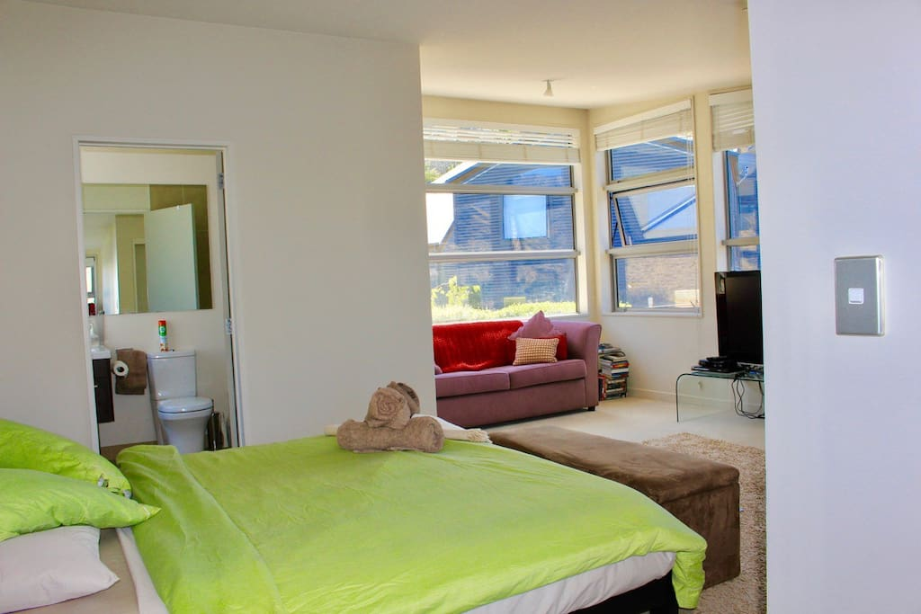Room overview with glimpse of your private living area and ensuite bathroom