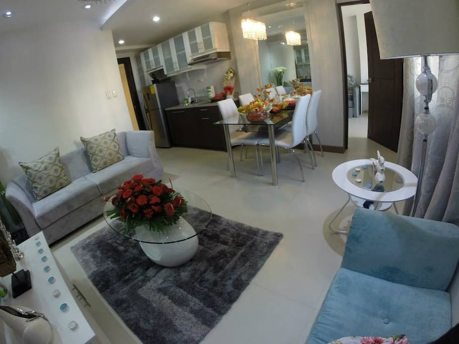 a sofa, a mini kitchen and dining area