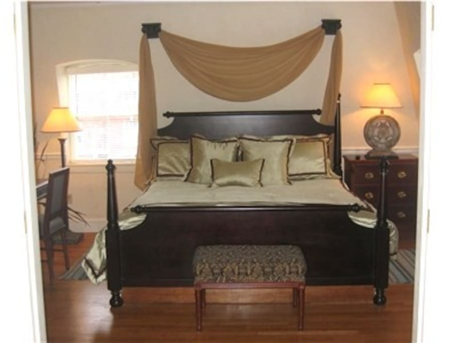 King bedded bedroom.