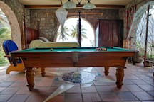 The pool table room and fourth bedroom has three enormous doors for views and ventilation.