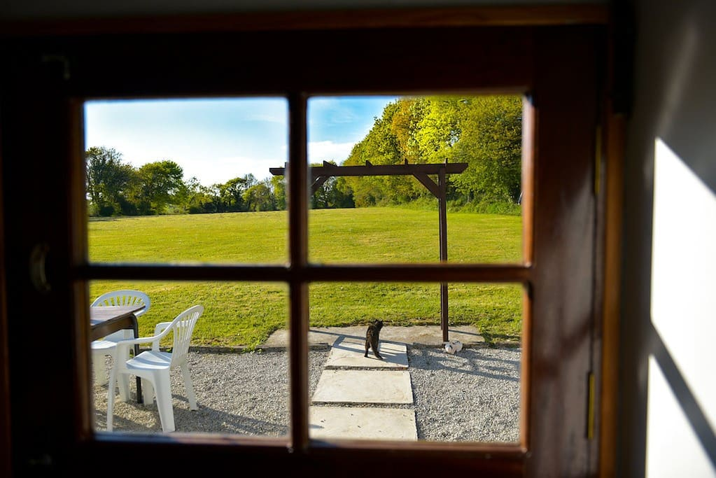 view from the kitchen stable door over the field and outdoor dining area
