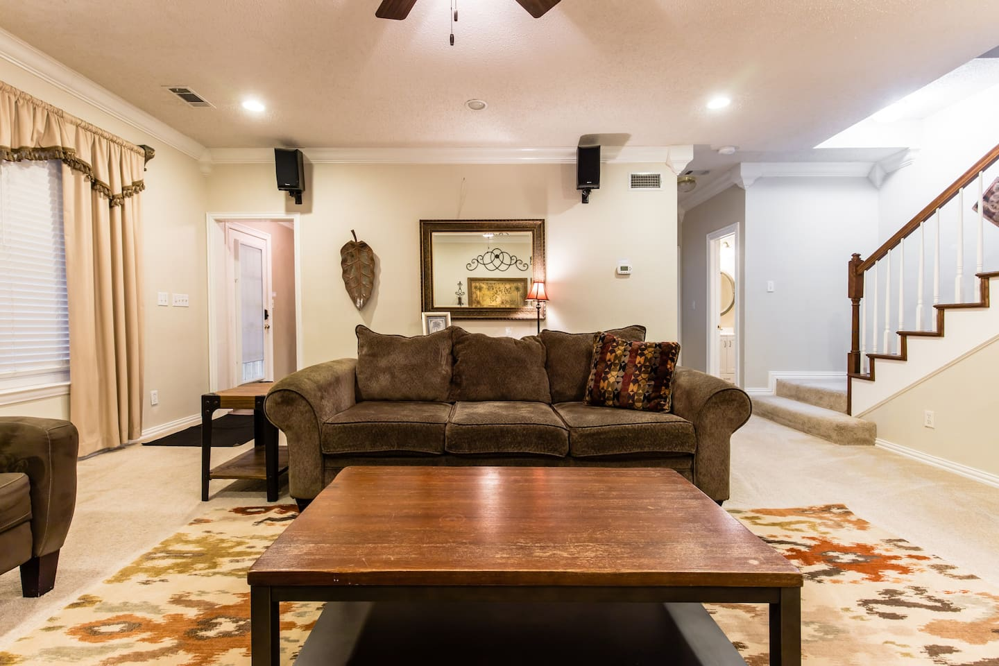Large downstairs living room for relaxing, socializing, playing cards, etc.