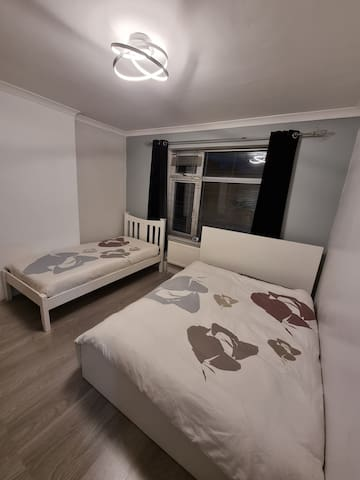 Room 1: Single bed + Double Bed