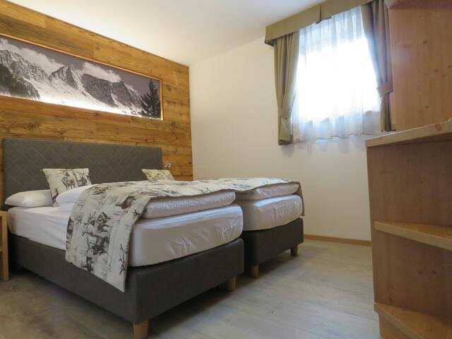 "Cosy Holiday Apartment ""Appartamento Caterina"" Close to the Ski Area, with Shared Garden, Mountain View, Wi-Fi & TV; Parking Available"