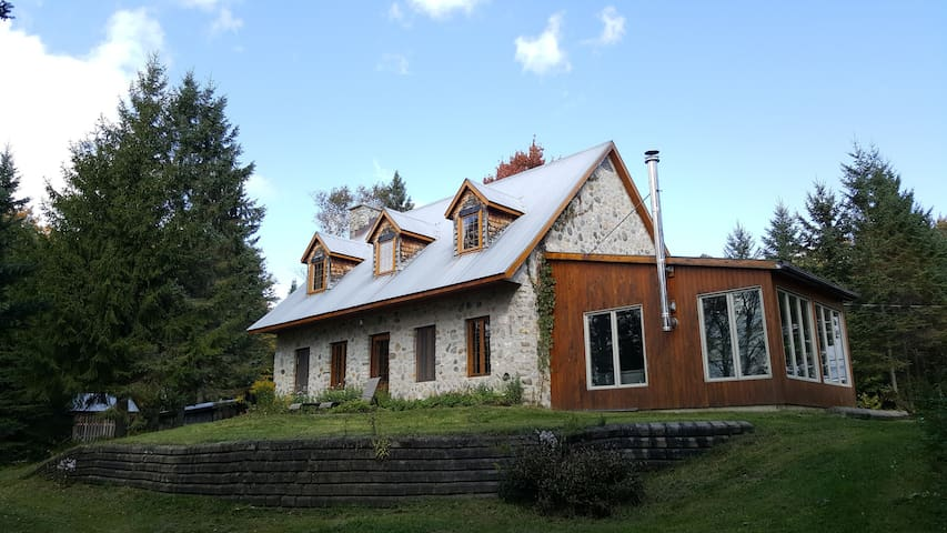 Large country house on 100-acre forest, near lake