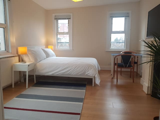 Simple clean light filled double room (Room 2)
