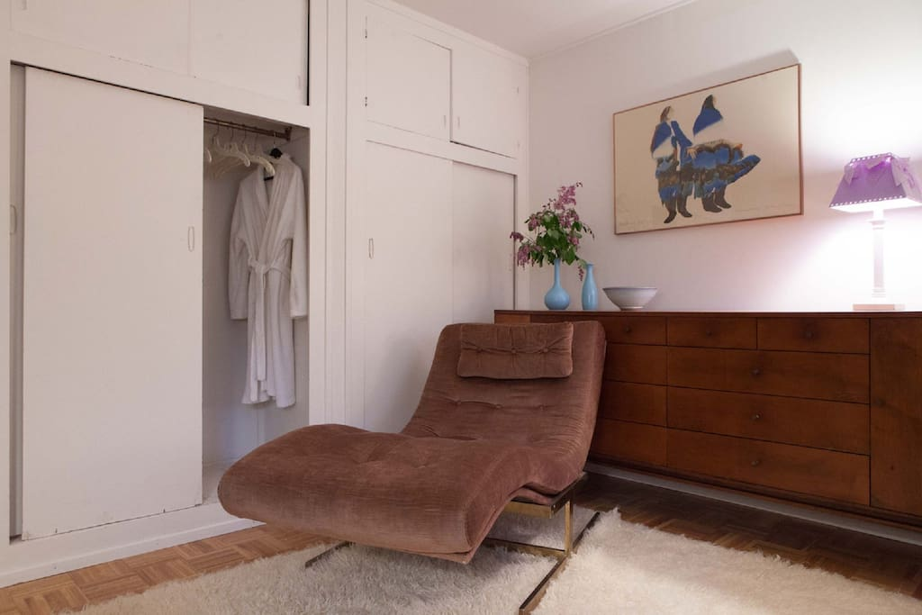 Bedroom w/ 4 closets, lounge chair, and dresser