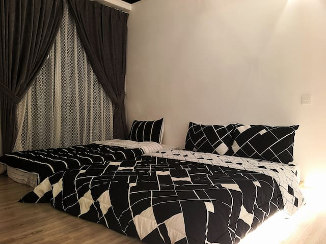 It's black it's white. My Habitat's bedroom, 1 Super Single and 1 Queen bed at your service!