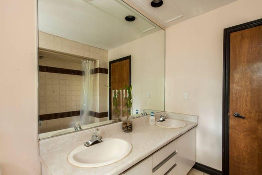Spacious Washroom with Bathtub and Shower