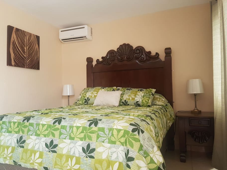 Bedroom with Full-Size Bed and Air Conditioner