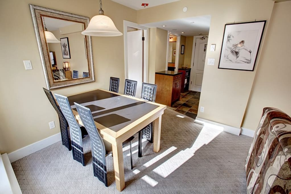 Enjoy your meals around the dining table with enough seating for everyone