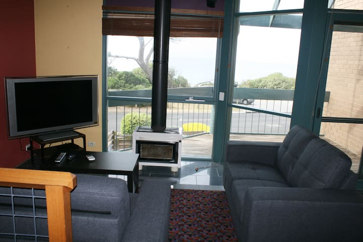 Lounge room with TV and set top box:  Free Wifi to use your Netflix account. Closed fire place for Winter. DVDs and CDs supplied.