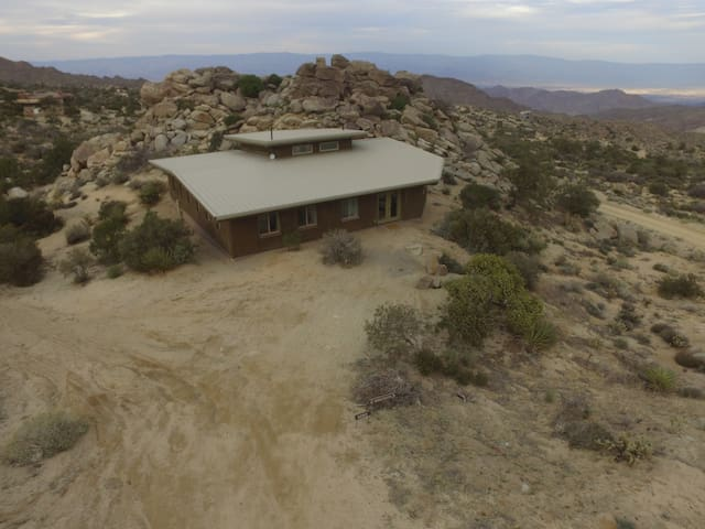 Drone shot of the 2 acre property and backyard rock formations