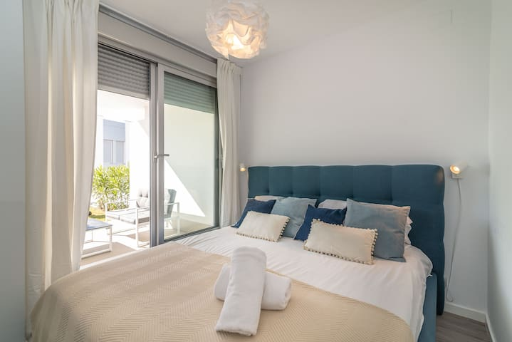 Bedroom # 1 · King-size bed (180 x 200 cm), air conditioning, direct access to the terrace, built-in closets, and an en-suite bathroom with walk-in shower and single vanity.