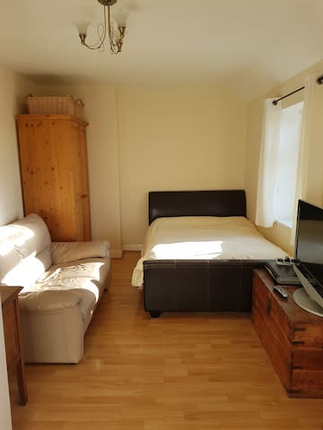 Large double room in friendly house.