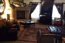 Large TV family room w fireplace