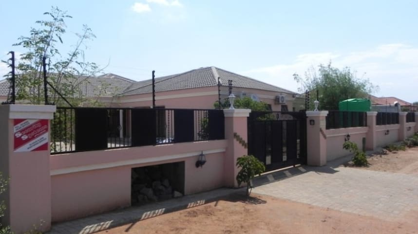 Whole house screen-walled, electric fence, security system and air-conditioned.