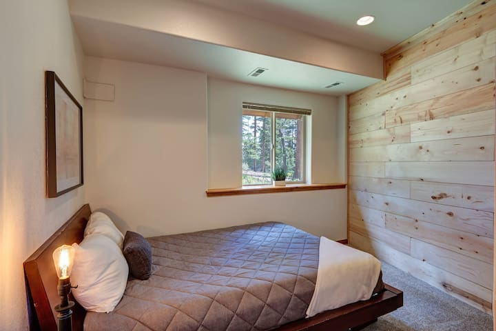 The 4th bedroom is located on the lower floor. This room offers a queen bed with memory foam topper and luxury linens.