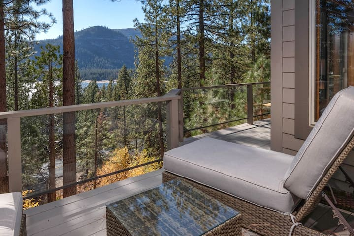 This home's multi-level deck offers stunning views of Lake Donner and surrounding peaks.