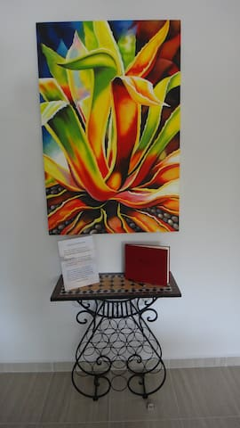 Welcome to Holladay House! This Agave plant, that Tequilla is made from, was painted locally.
