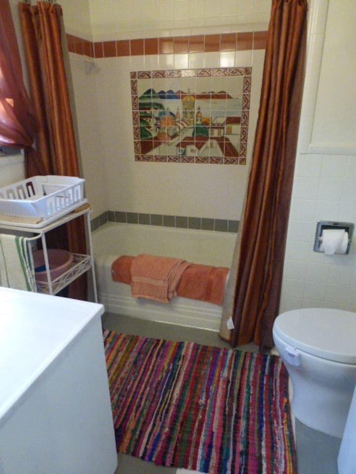 Full private bath in upstairs hall, tub & shower
