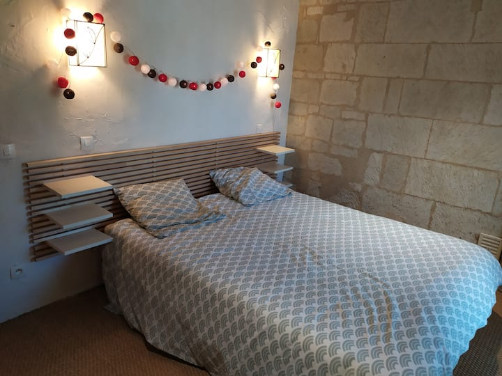 Grande chambre confortable chez l'habitant