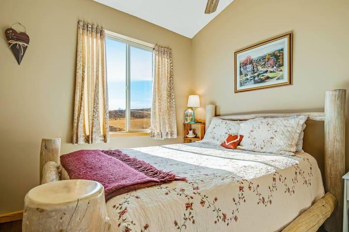 (main floor)upstairs bedroom two with queen