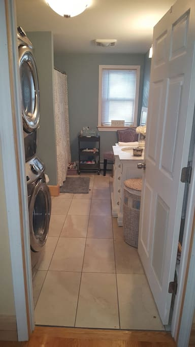Spacious bathroom with washer & dryer.