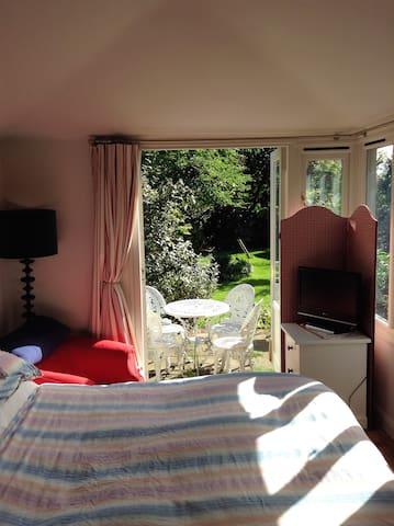 Bedroom with doors on to the garden