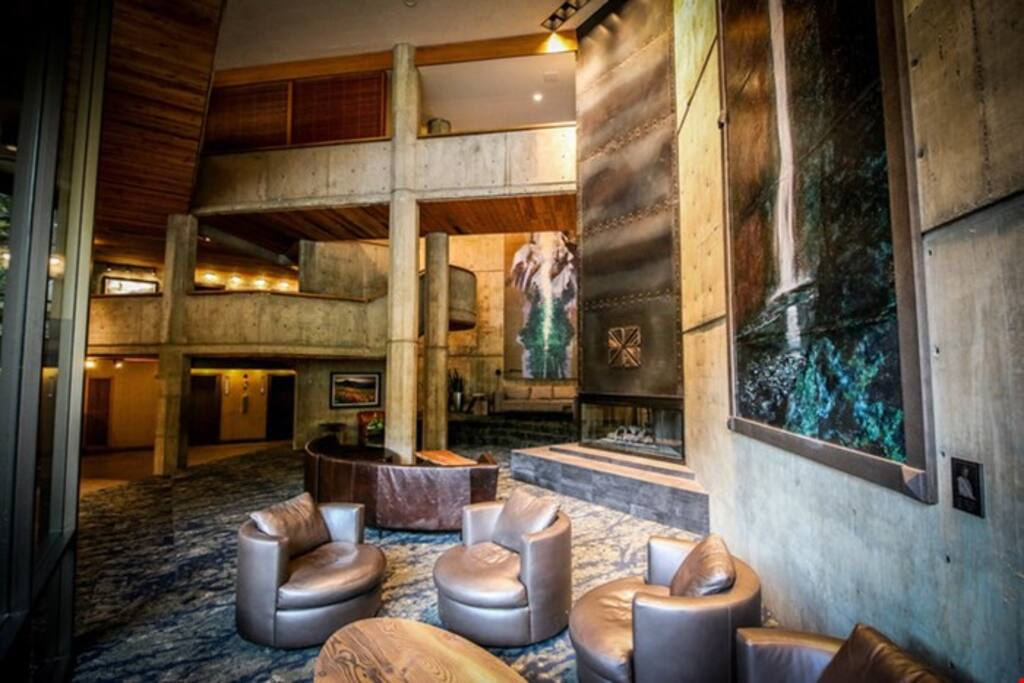 Warm up in front of the fire in the beautiful lobby at the Iron Blosam Lodge