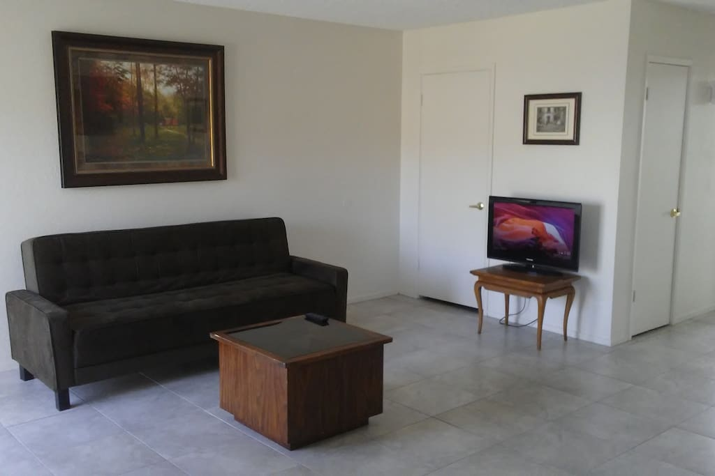 Our living room has an elegant dark brown futon that can be converted into a full size bed. Chromecast compatible television with free WIFI internet.