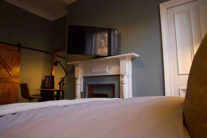 """42"""" Smart TV in the bedroom - rotates from the wall so that you can comfortably watch TV in bed easily..."""