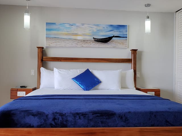 King size bed with extra pillows