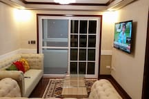 """Living room with smart Samsung 60"""" tv"""