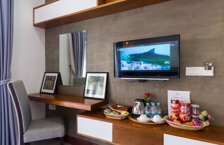 writing desk, tea and coffee and amenities like this for every room