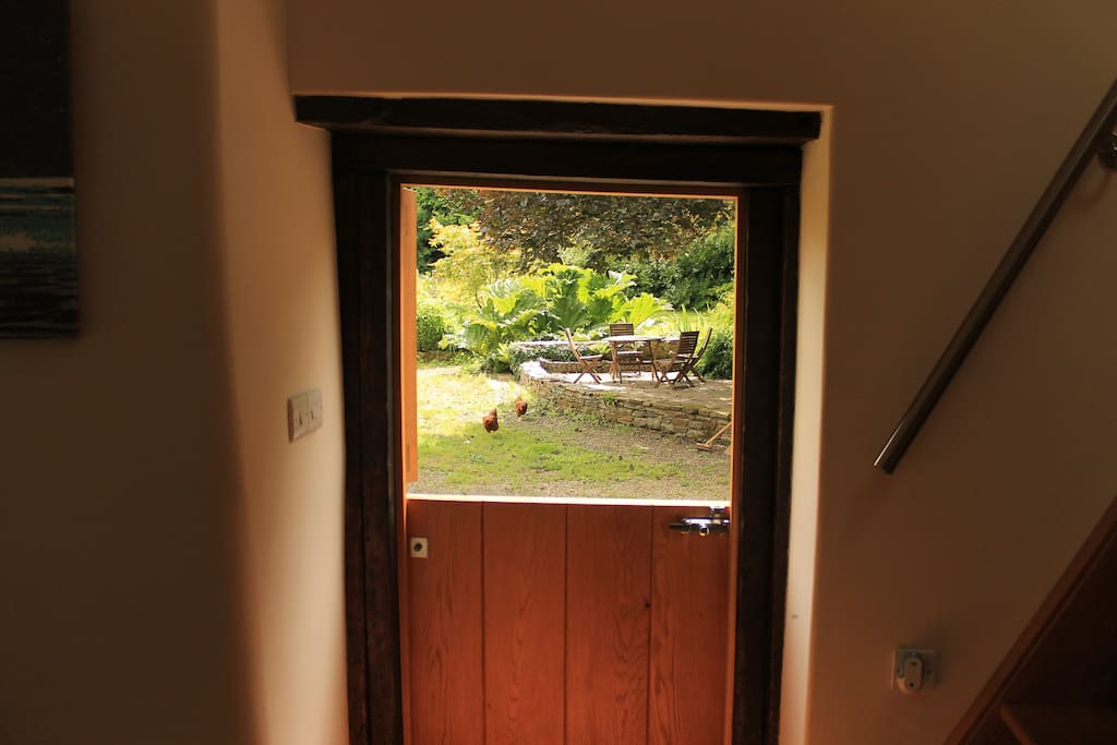 The Hide's stable door opening onto the gardens of Lemons Farm