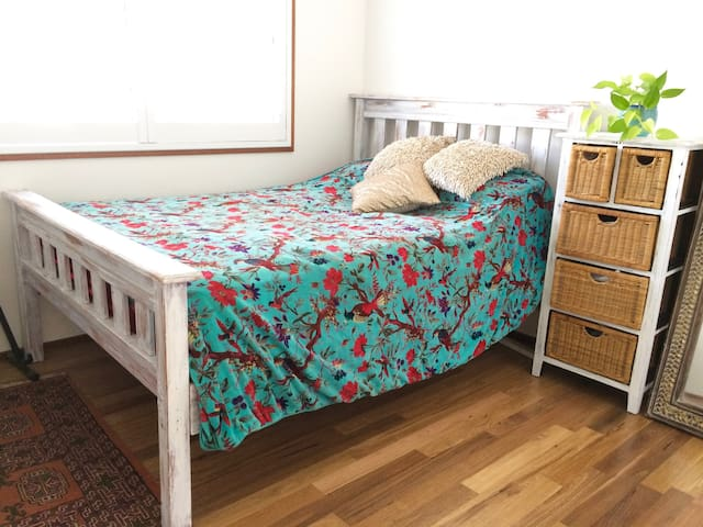 Bedroom 2 has hardwood timber floors & solid timber shabby-chic Queen sized bed & plenty of cupboard space. Fall asleep to the sound of the ocean