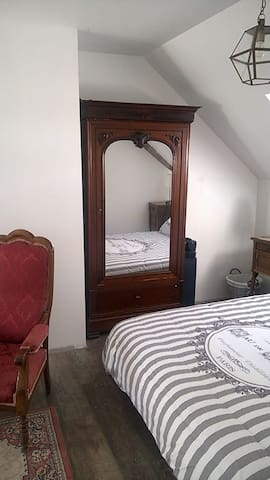 Anique wardrobe with original mirror.