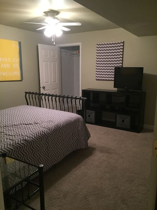 Bedroom is large enough for two adults. Walk-in closet and private restroom entry.