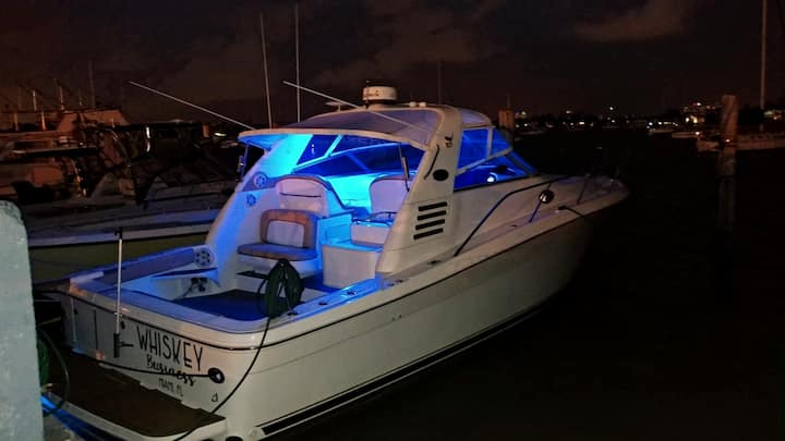 Our yacht glowing at night