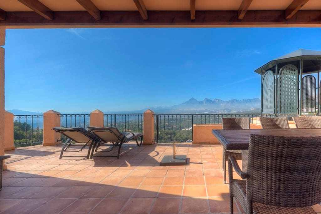 Spacious private terrace with views over the valley and the sea