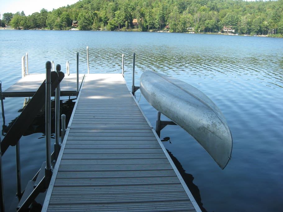 Aluminum dock with canoe.  Deep water at the end.  Shallow for wading nearer shore
