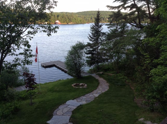 Stone walkway from house to fire-pit and lakefront.