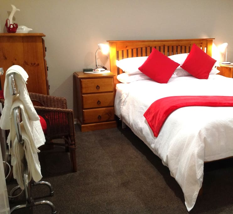 Bottlebrush Room Queen size bed, wardrobe, toweling robes, heated towel rail, airconditioner and much more.