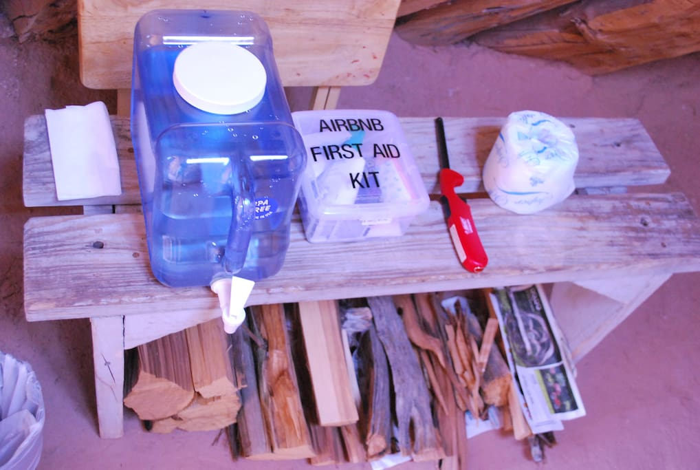 Filtered drinking water, first aid kit, lighter and toilet paper.