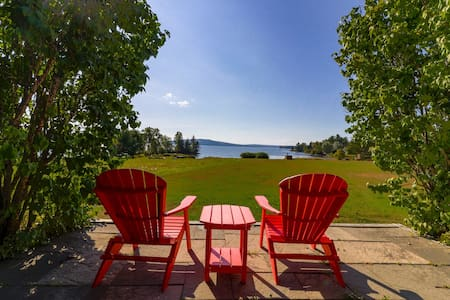 2 lakefront, dog-friendly cabins on 4 acres w/ porches, dock, & lake views