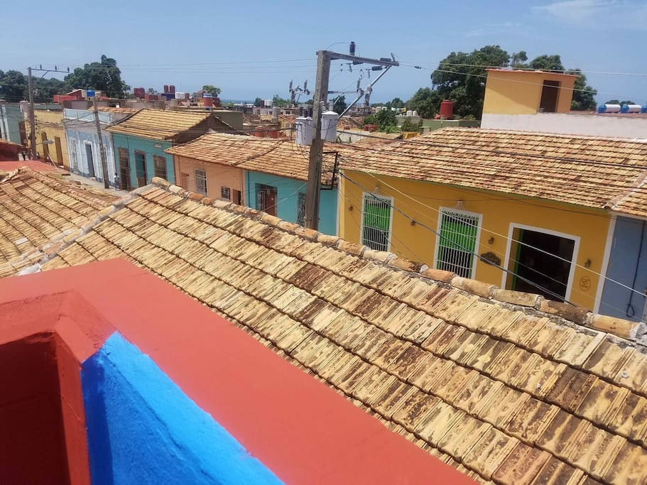 View from sun deck, see the colourful row of houses below