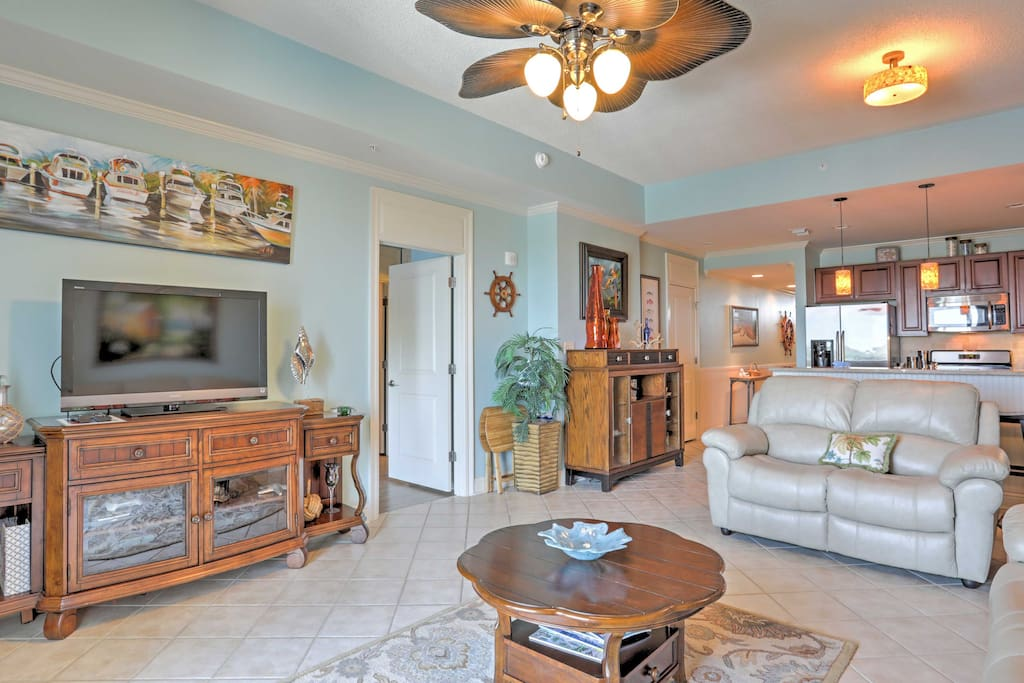 The charming condo features modern amenities and beach decor.