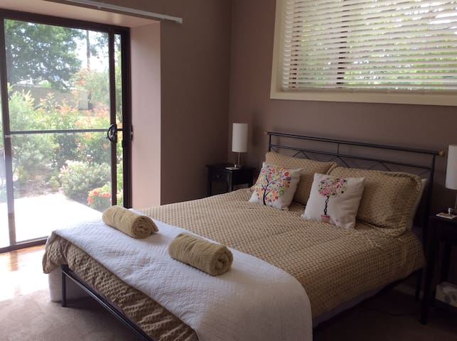 Large bedroom with Queen bed and separate ensuite facilities.