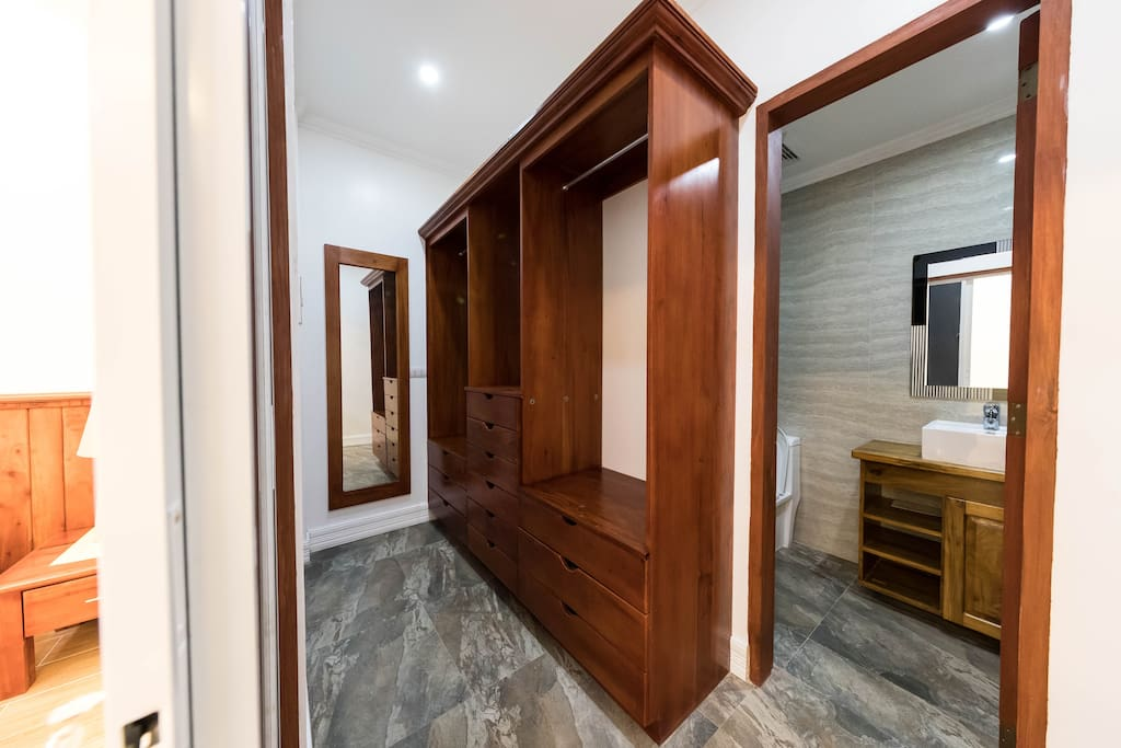 walk in closet and bathroom for the master's bedroom